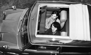 Musician Mike Nesmith, of pop band 'The Monkees', peering out of the roof of his Mini with his girlfriend, July 3rd 1967. (Photo by Keystone/Hulton Archive/Getty Images)